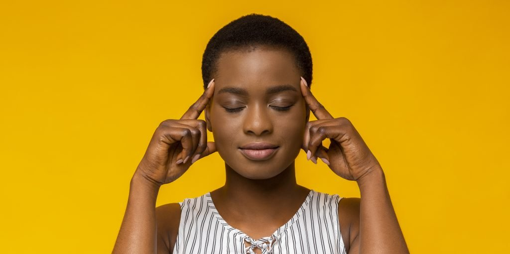Woman thinking hard with eyes closed