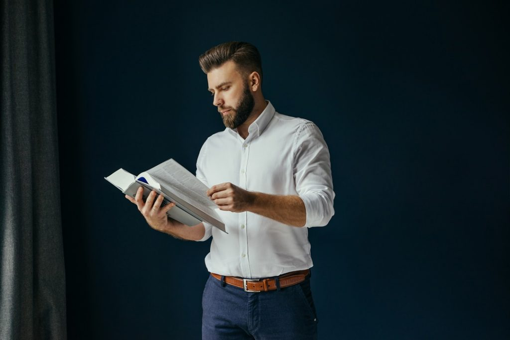 Man reading thick book